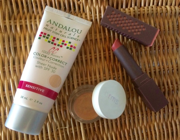 Summer beauty products: tinted moisturizer, lipstick, and bronzer